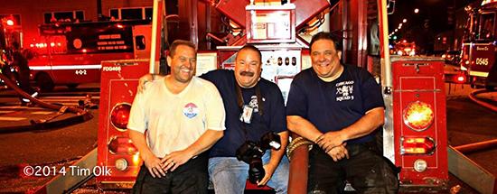 firemen posing at a fire scene
