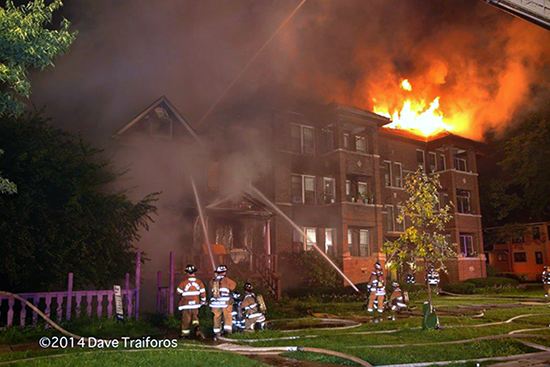 apartment building on fire at night