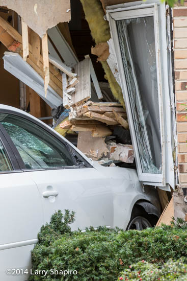 car drives into house and damages structure