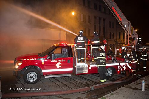 Chicago FD turret wagon at a night fire scene