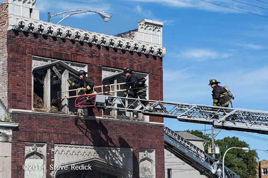 Chicago firemen use stripping ladder