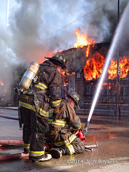 firefighters with multi-versal at huge fire