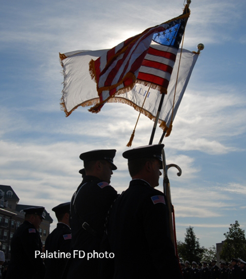silhouette of firemen with American flag