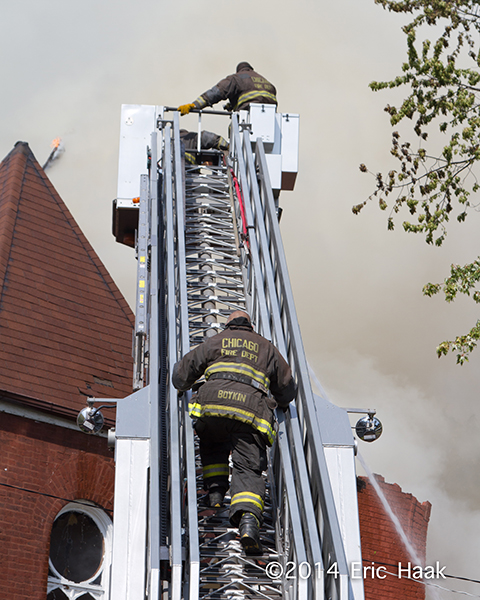 fireman climbing tower ladder
