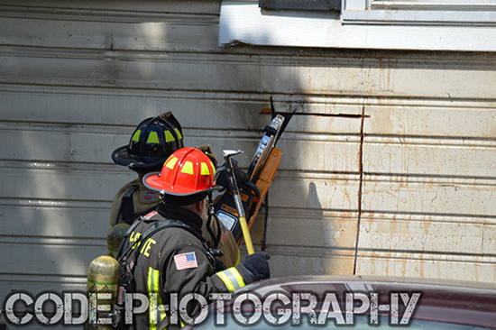 firemen breach wall with saw