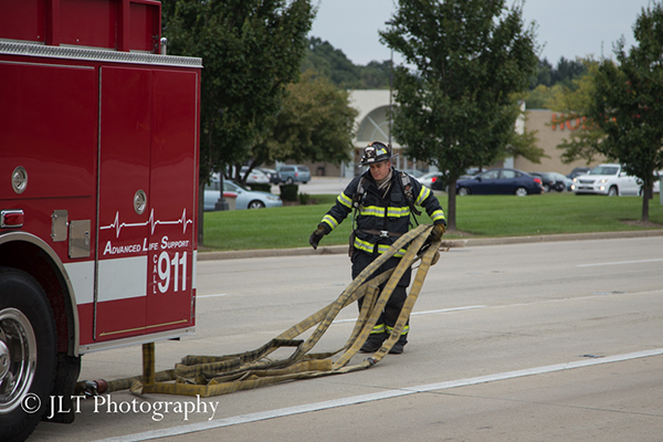 fireman stretches hose