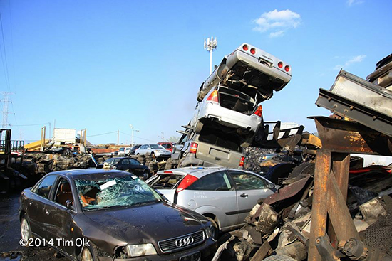 stack of cars in a junk yard