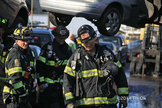 firemen working in a junk yard