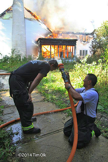 fireman cools off at fire scene