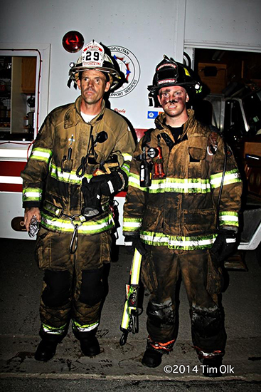 firemen in heat covered with oil and grease