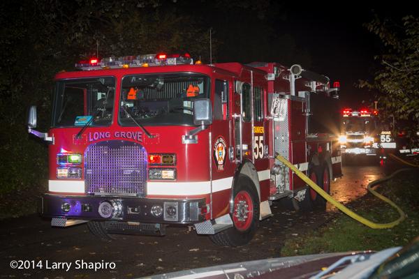 fire department tanker nurses fire engine at fire scene