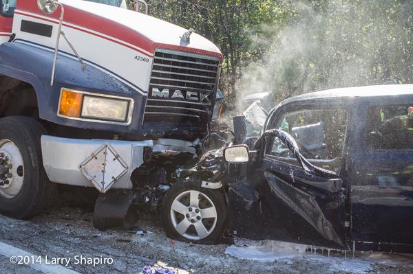 car crashes head-on with semi