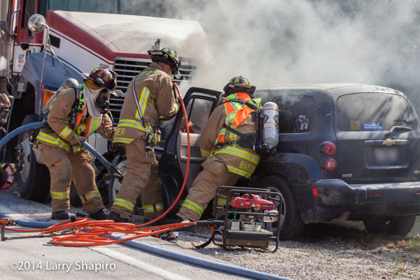 car fire with trapped driver