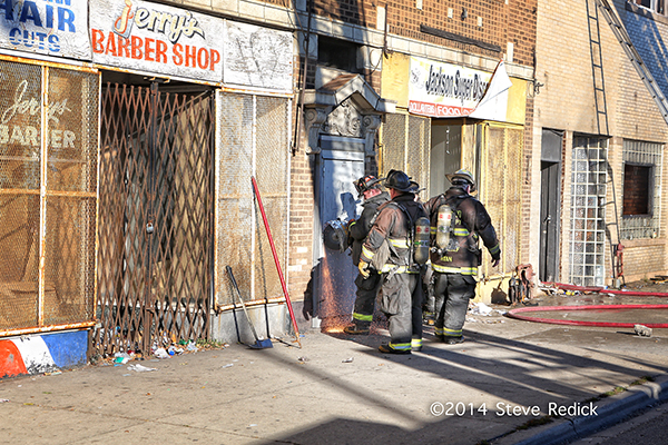 firemen force entry into storefront