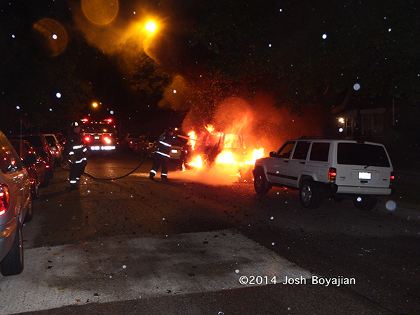 car engulfed in flames at night