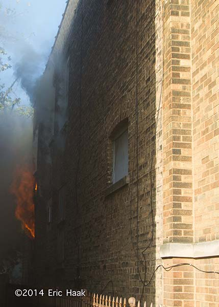 flames blowing out a window