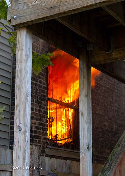 flames through building window