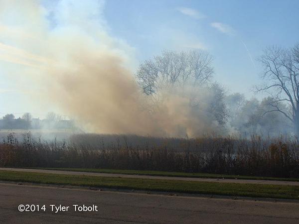 brush fire scene with lots of smoke