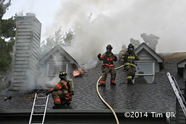 smoke from the roof of a house fire