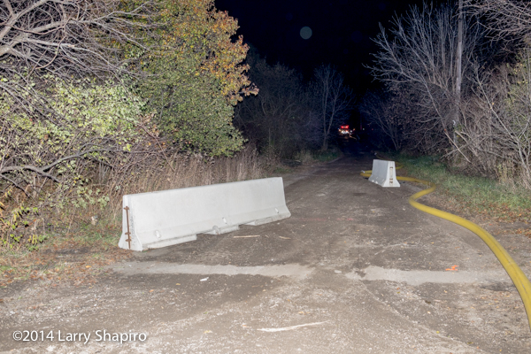 Jersey barriers on rural road at night