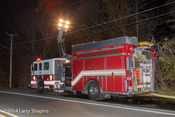 Round Lake FD engine at night fire scene with Command Light