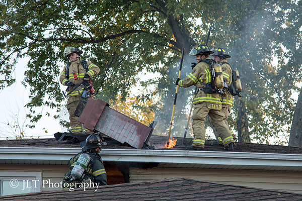 firemen workon chimney fire