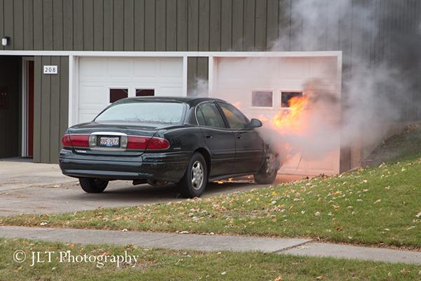 car fire in driveway