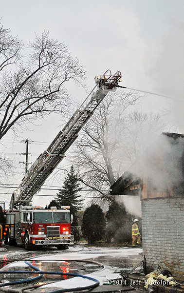 Pierce aerial with master stream at fire scene
