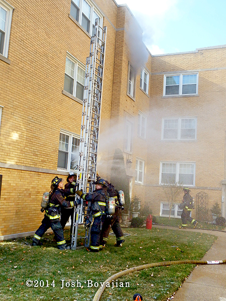 firefighters raise ground ladder