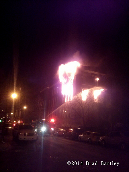massive flames from building fire in Chicago at night