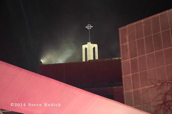 smoke from Catholic hospital at night