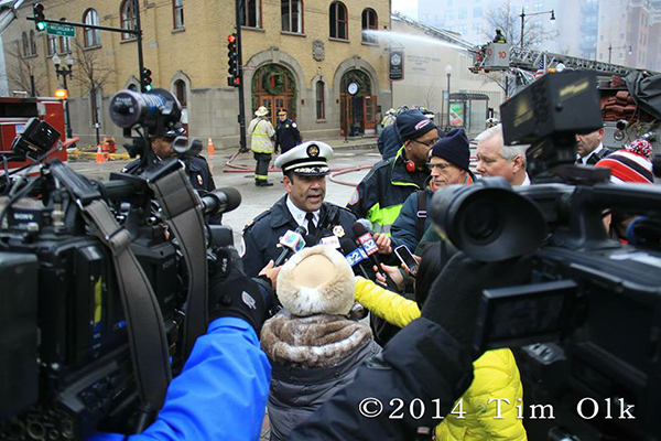 Chicago Fire Cofmmissioner Jose Santiago addressing the press