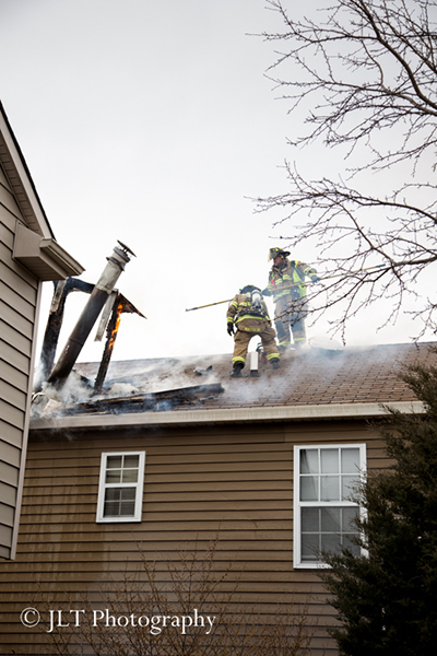 firemen working at a fire scene