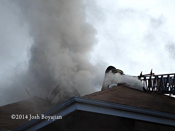firemen vent roof in smoke