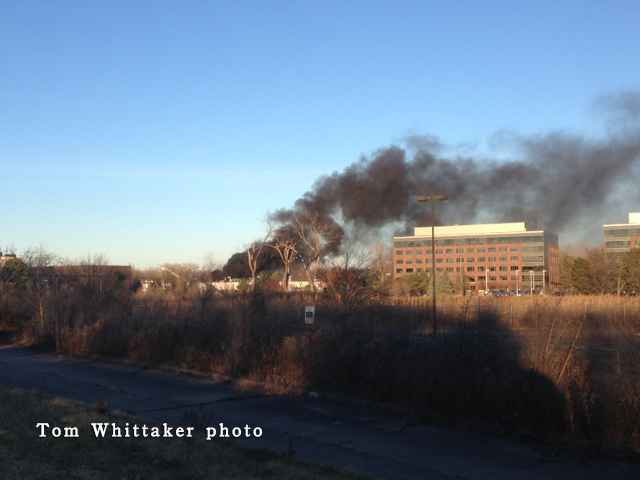 smoke from roof fire at commercial building