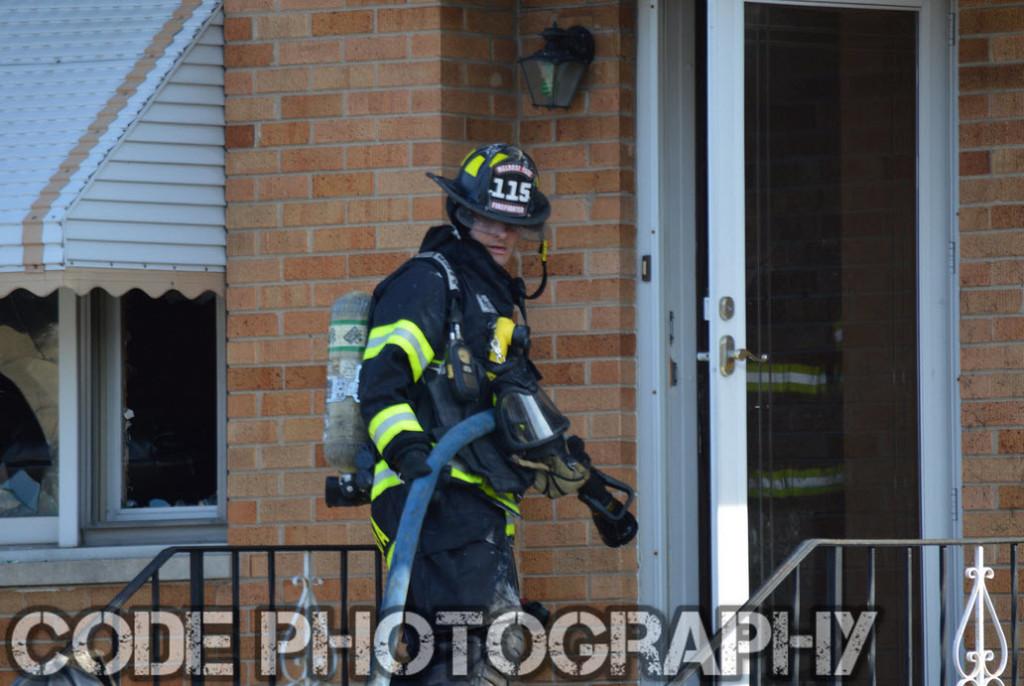 fireman with hose line