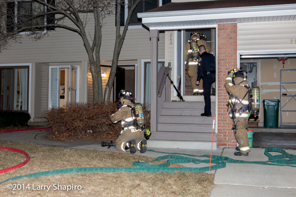 firemen gear up to make entry