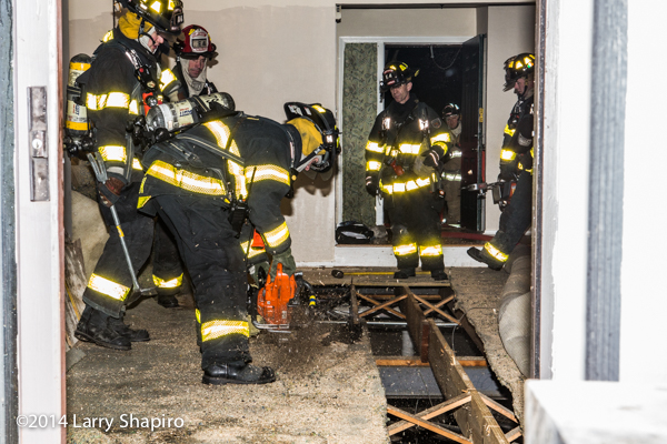 firemen access crawlspace fire