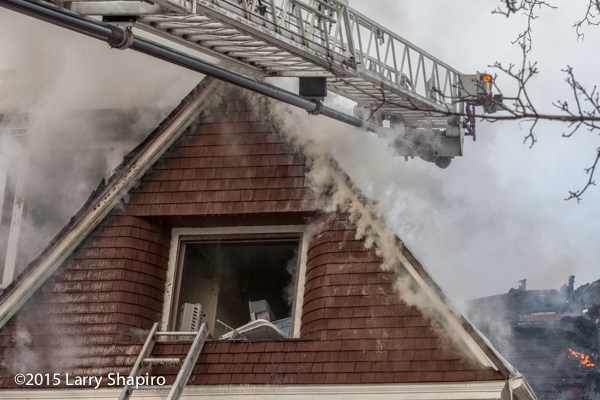 house fire with aerial ladder