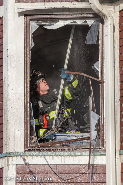 fireman overhauls house after fire