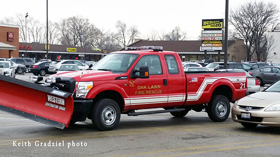 fire department pickup truck with snow plow