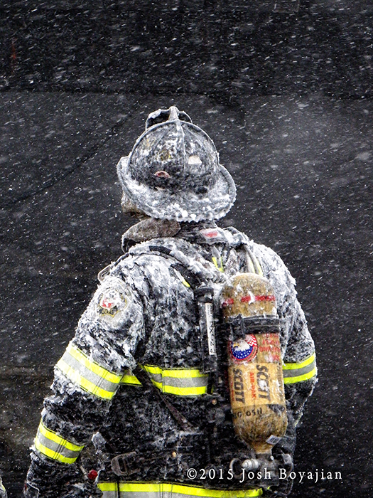 firefighter covered with ice and snow