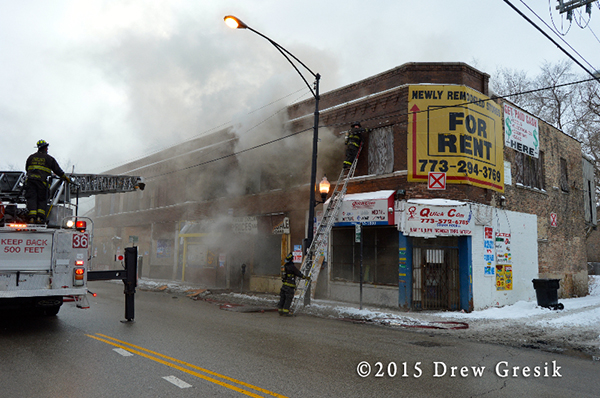 commercial storefronts on fire