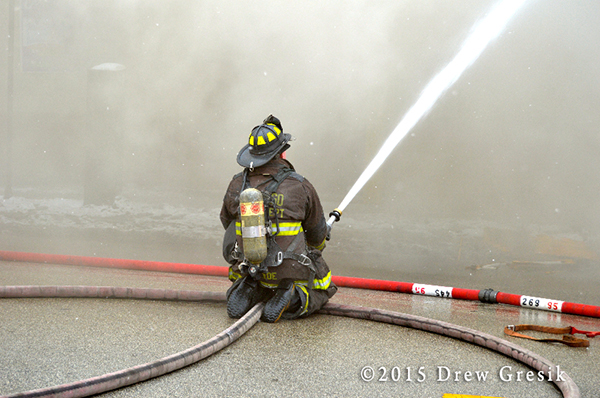 fireman in smoke with deluge gun