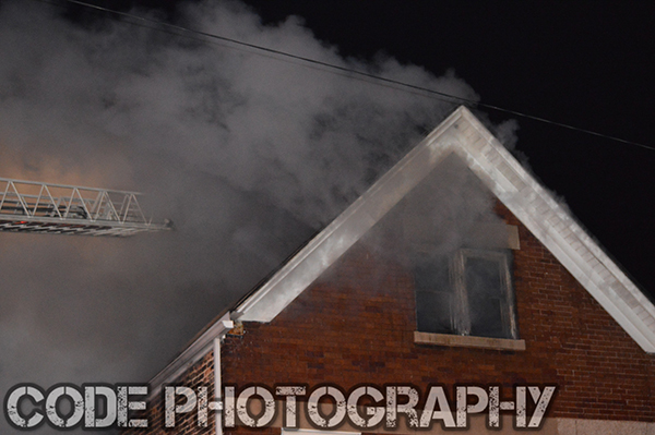 smoke from house fire at night