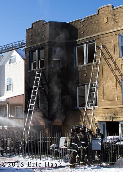 apartment building  covered with soot from fire