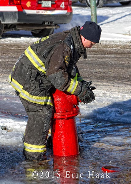 fireman with hydrant in ice and snow