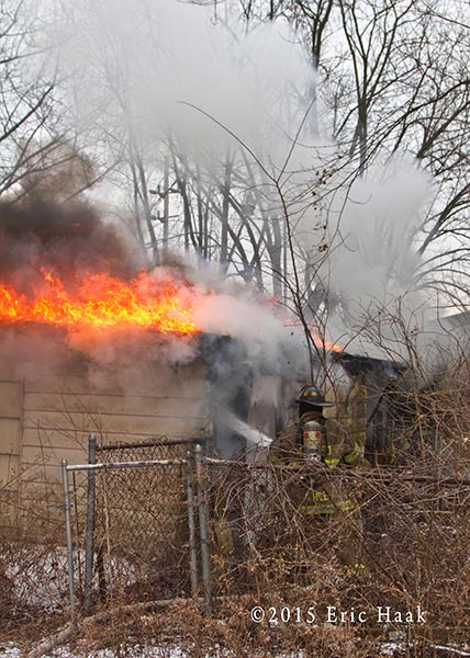 fireman with a line on a vacant house fire