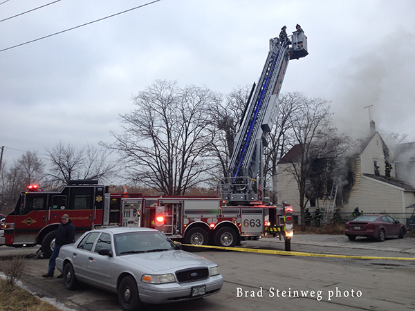 fire scene with tower ladder