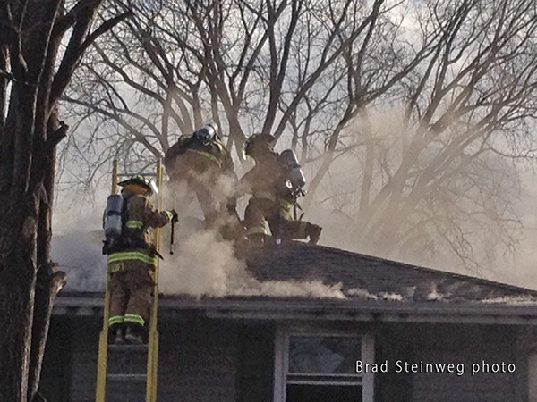 house with fire in the attic